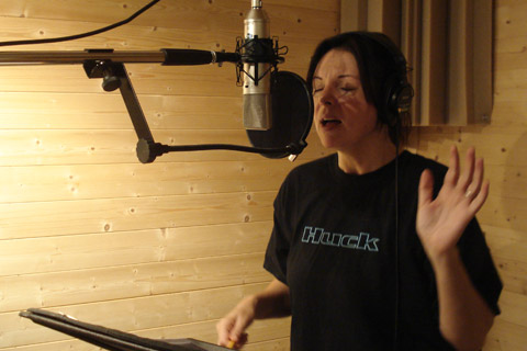 Marcia Ramirez singing on a CD project.