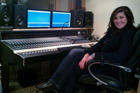 Rachel sitting at the Board in Panda Productions Studio in Nashville Tennessee